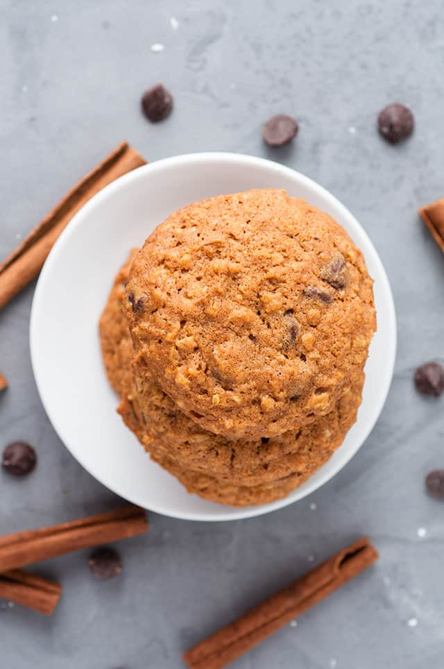 overhead photo of pumpkin oatmeal chocolate chip cookies on a white dessert plate