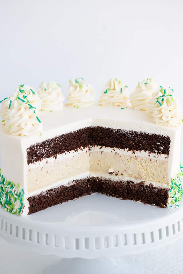 cake with a slice missing on a white cake plate showing the inside layers