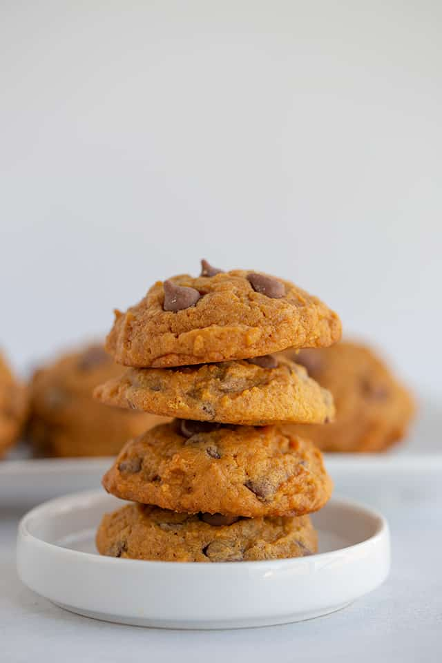 stack of pumpkin chocolate chip cookies on a small white plate