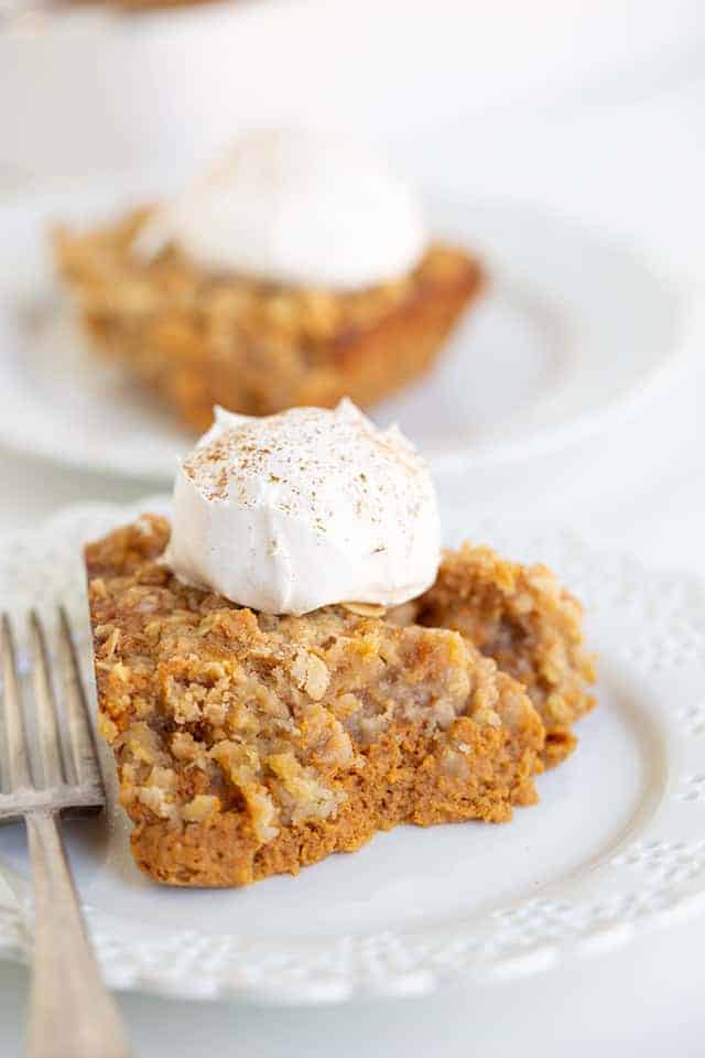 pumpkin crisp on a white lace plate with a fork