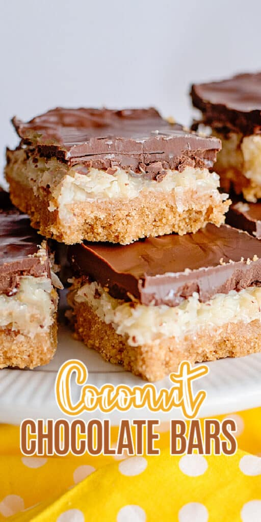 zoomed in photo of stacked coconut chocolate bars on a white cake plate with text at the bottom