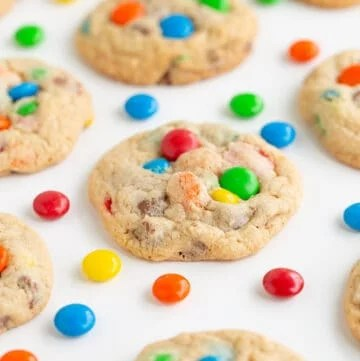 photo of cookies on a white background with m&m candies around the cookies