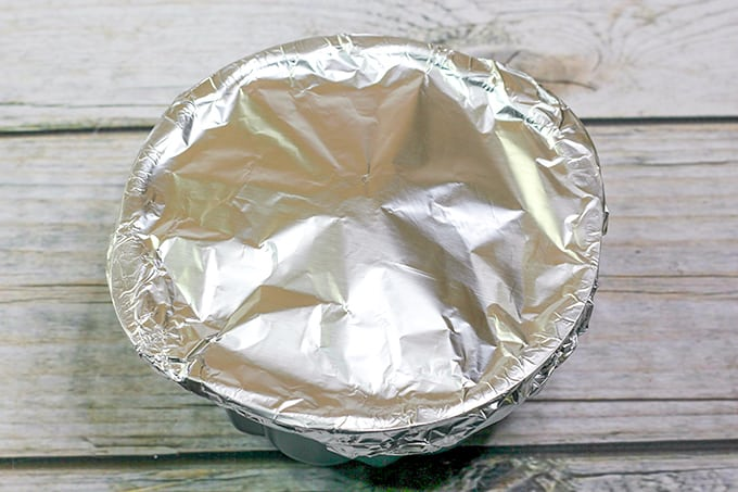 bundt pan covered with tin foil