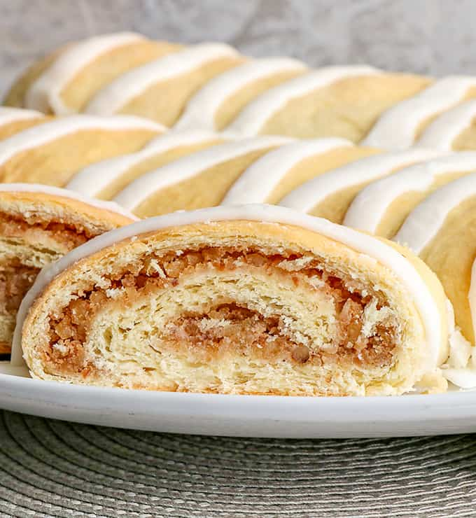 up close photo of the nut rolls showing the swirl of filling on a white platter