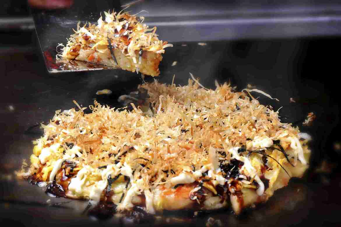 Okonomiyaki prepared on plate grill