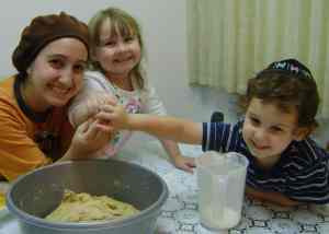 Yosefa and family making challah