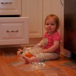toddler getting into a drawer in the kitchen