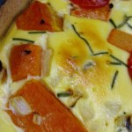 winter squash quiche with tomatoes, chives, cheese and whole-wheat oil crust