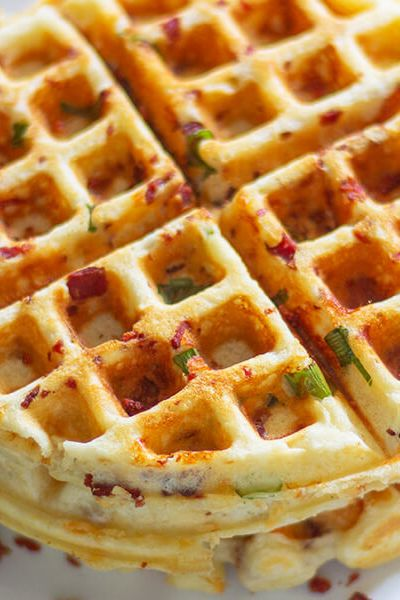These easy bacon cheese waffle is super crisp on the outside and light on inside. Adding cheese, bacon and scallions makes this recipe perfect anytime.