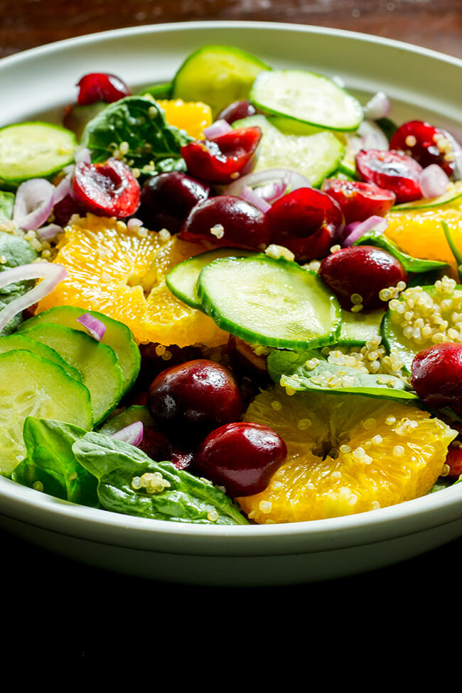 This salad is quick and easy, it requires little cooking. Cherry, orange, quinoa, spinach and cucumber covered in a lemon poppy seed dressing is perfection.