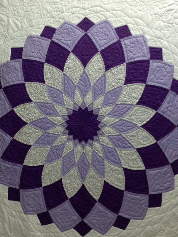 The hubs favorite. This is not a block - it's a full size quilt.  I couldn't get far enough back to get a full picture.
