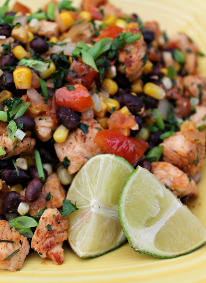 This colorful Southwestern chicken dinner recipe is packed with corn, black beans, fresh cilantro, tomatoes, and lime, it's bound to become a favorite, no matter what season!