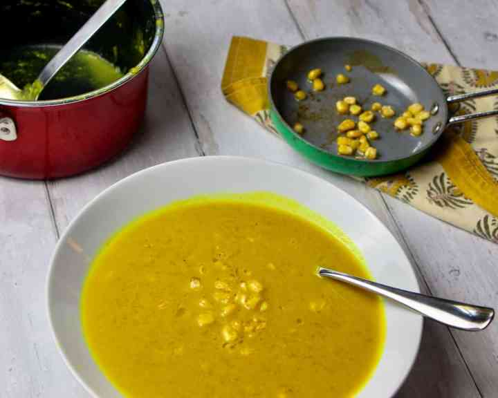 Bowl of pumpkin and sweetcorn soup with roasted sweetcorn bits on top