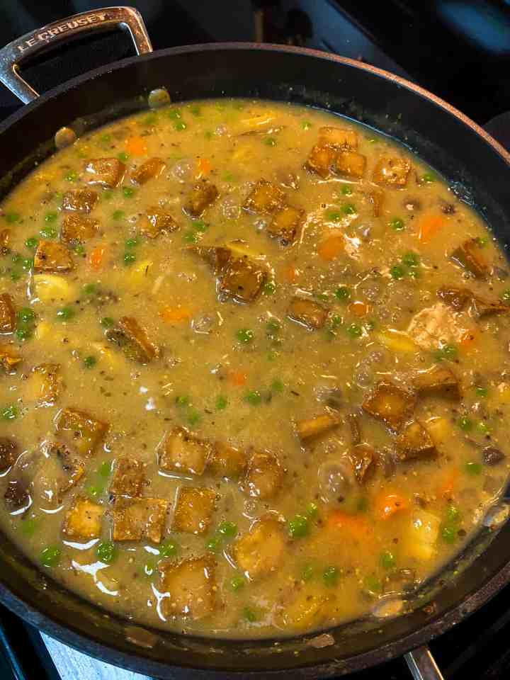 photo of pot pie filling mixture bubbling in a pan.