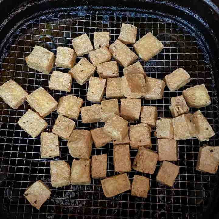 photo of tofu cubes cooking in the air fryer