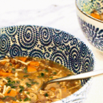 Pinterest graphic showing Veggie Noodle Soup. A richly flavoured miso-based vegetable soup with puy lentils, tiny diced vegetables and little gluten-free noodles make this a wonderfully comforting vegan soup.