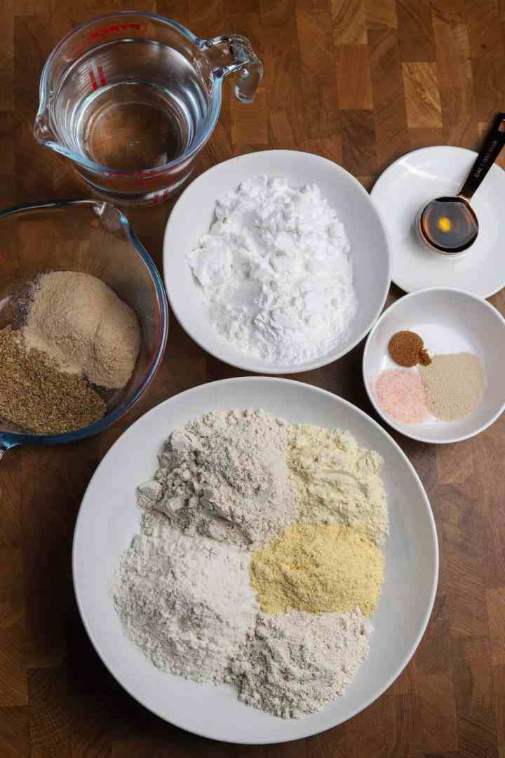 Photo of all the ingredients in bowls on a wooden tabletop.