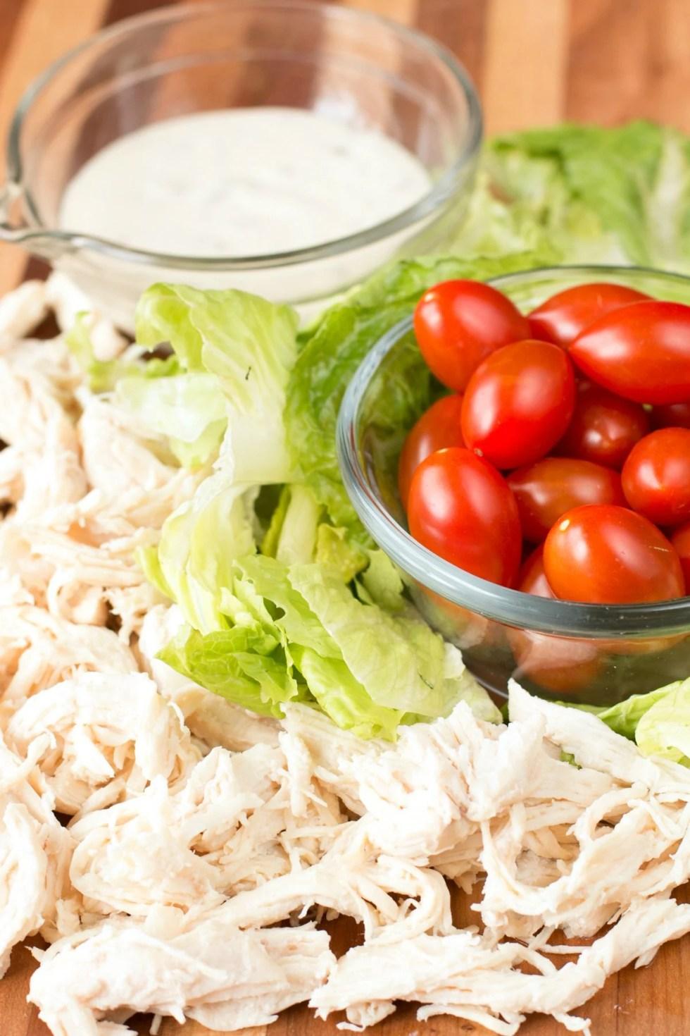 Chicken Caesar Wrap Ingredients on a cutting board