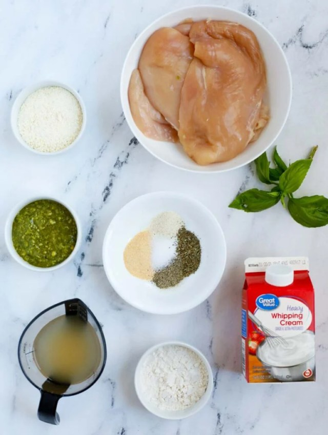 Top down shot of ingredients for creamy pesto chicken.