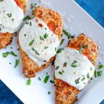 Baked parmesan chicken with marinara sauce and cheese
