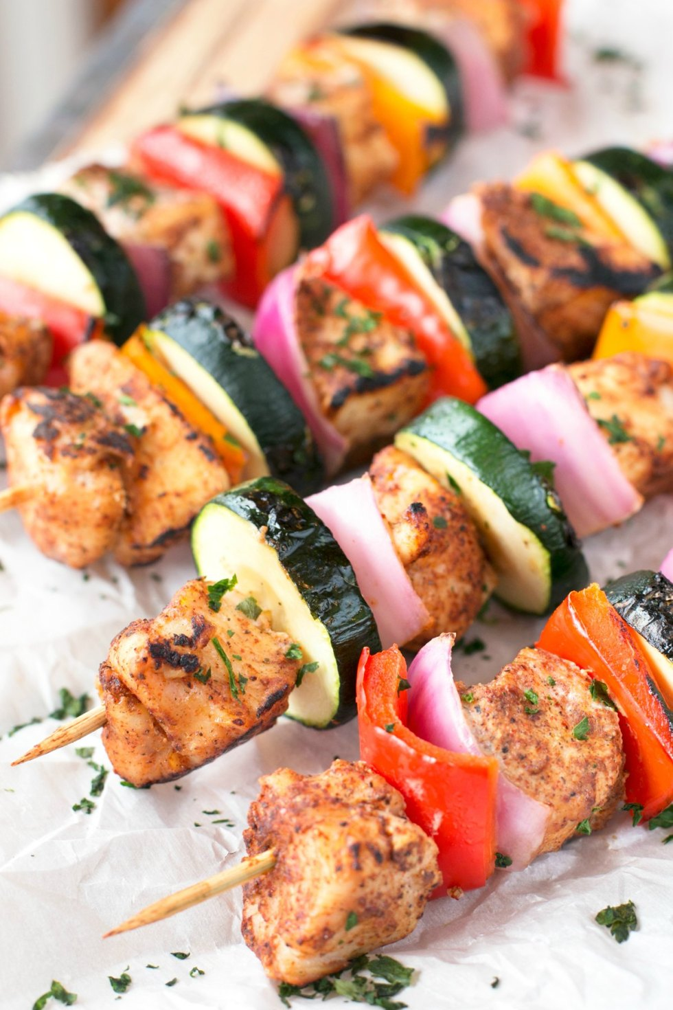 Chicken skewers with zucchini pepper and onion on a baking sheet