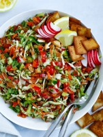 cabbage fattoush salad served in a white bowl