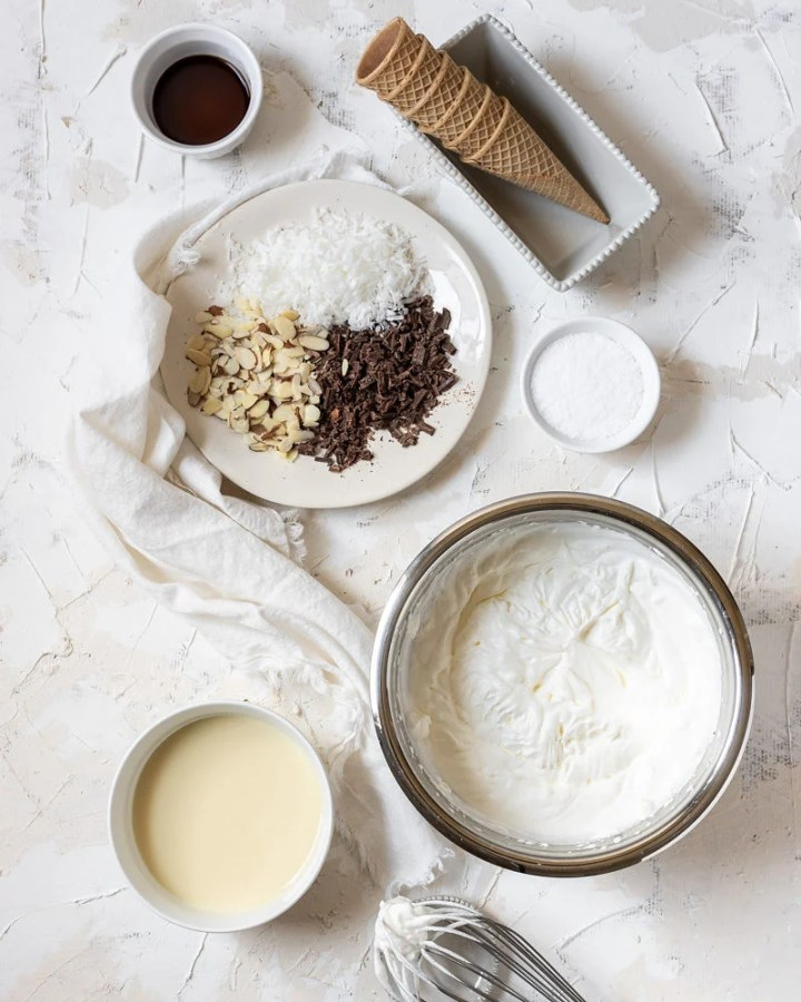 ingredients of the almond joy ice cream laid on a table
