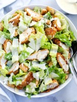 chicken caesar salad served in a dish