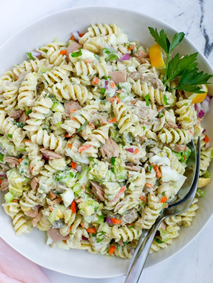 Tuna Pasta Salad Recipe in a bowl with a fork and spoon