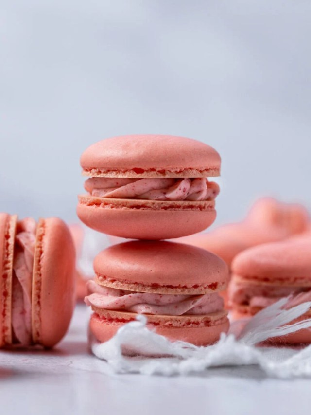 A stack of three strawberry macarons.