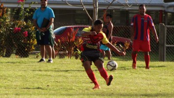 Anthony Samuela of Puaikura clears the ball from his opponent