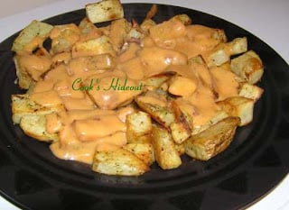 Oven Roasted Potatoes with Cheese sauce