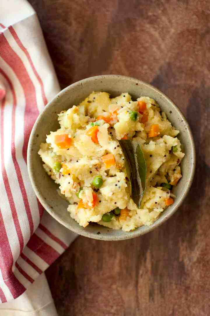 Grey bowl with vegetable upma