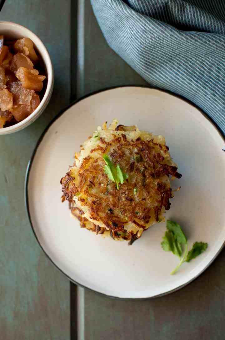 Grey plate with crispy potato pancakes
