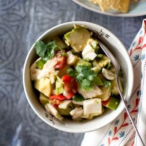Grey bowl with avocado, tomato, coconut meat salsa
