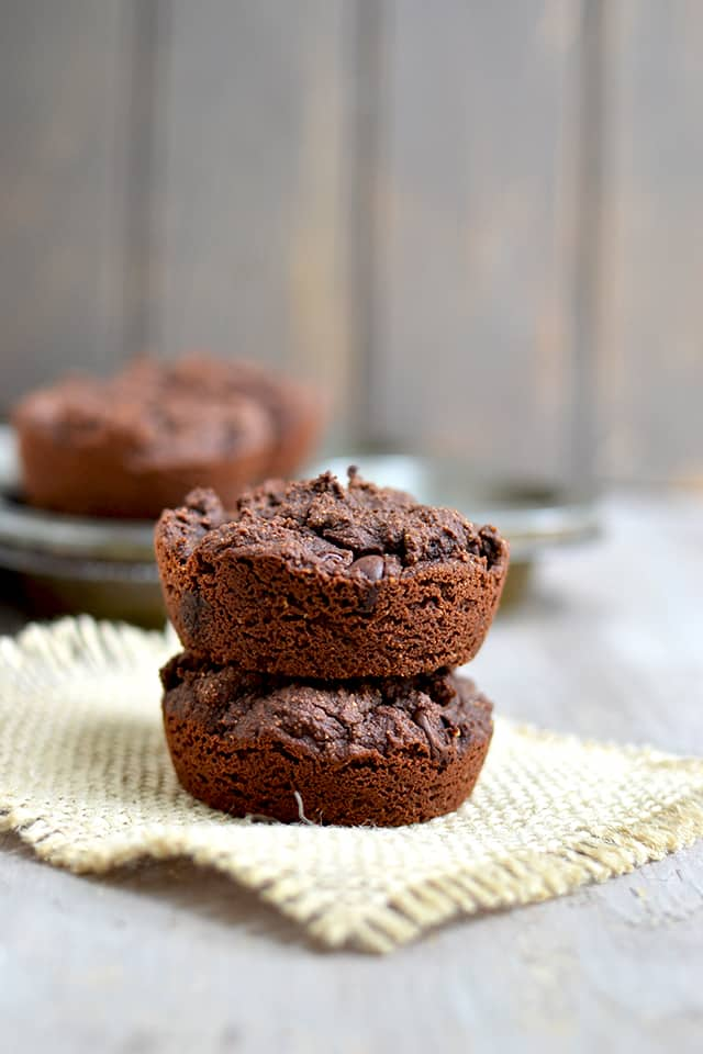 2 coconut flour chocolate muffins stacked on top of each other