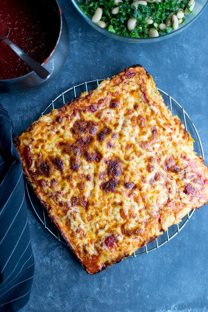 Steel rack with cheese pizza