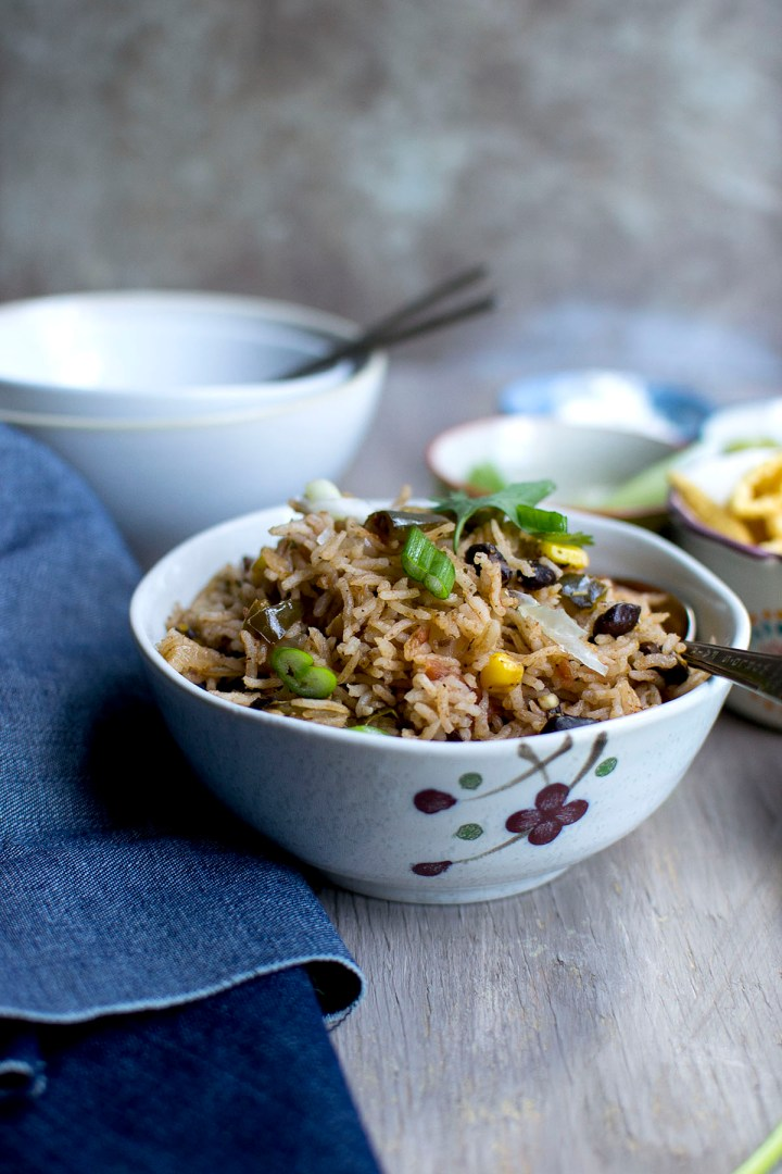 Grey bowl with black beans and rice