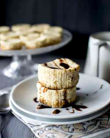 Stack of mini cheesecakes with chocolate drizzle