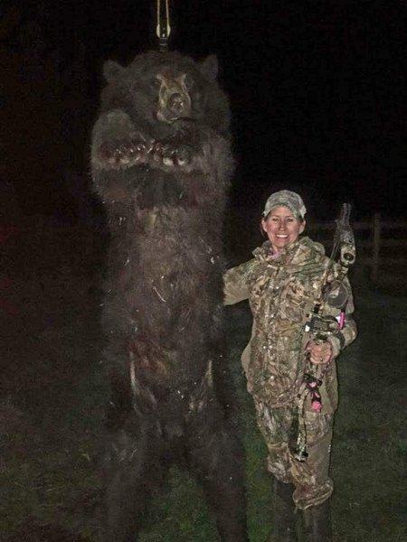 female hunter black bear - image