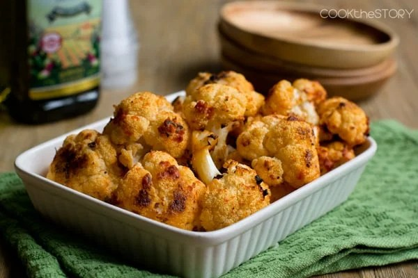Roasting cauliflower makes it sweet and tender. Here it's tossed with Italian flavors first to make this side dish even more delicious.