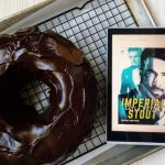 Chococlate bundt cake with ganache and Kindle with ebook cover of Imperial Stout by Layla Reyne featuriing two men in suits on the cover