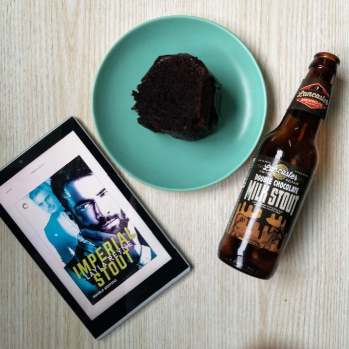 Imperial Stout cover on a Kindle, double chocolate milk stout beer bottle and cake slice on a small blue plate