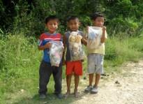Mopan Maya Children Help in a Village Cleanup