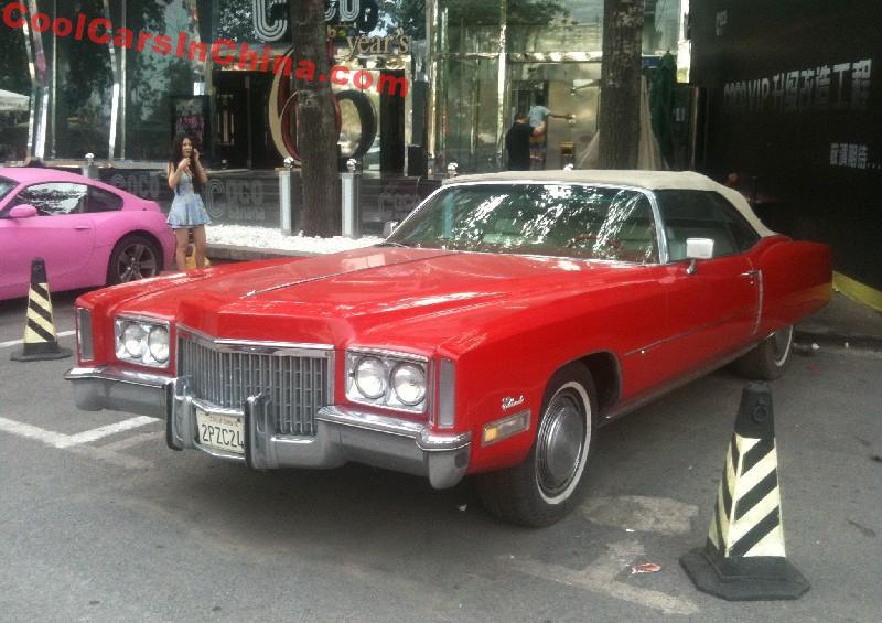 cadillac eldorado is a big red american convertible in china. Black Bedroom Furniture Sets. Home Design Ideas