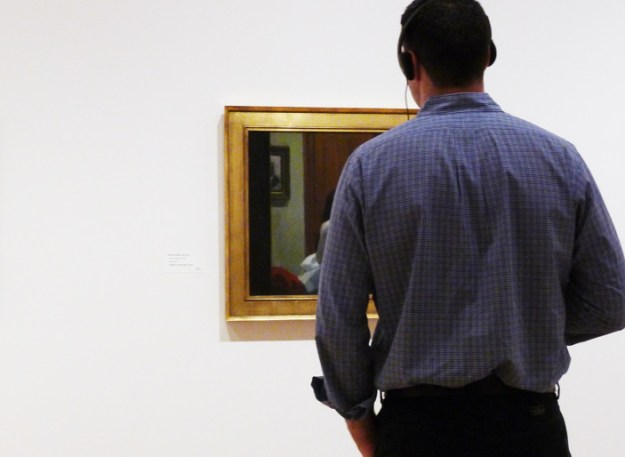 visitor looking at a painting