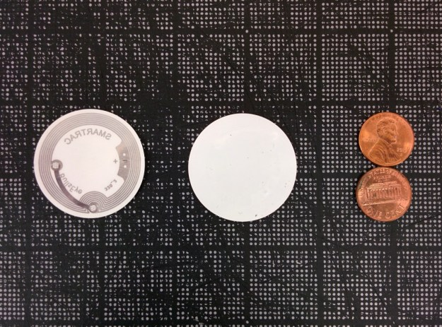 The front and back of the NFC tag we use in our labels, with pennies for scale