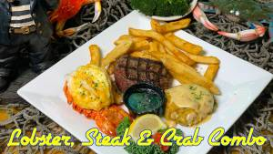 $19.95 gets you a one quarter pound broiled lobster tail, and a six ounce grilled sirloin fillet accompanied by a bistro crab cake topped with lobster sauce!