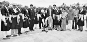 Founder of the Kodava Hockey Festival Pandanda Kuttappa (Kuttani) tapping the silver hockey ball with a silver hockey stick to inaugurate the Machamada Kodava Hockey Festival at Ponnampet in Kodagu on Friday.