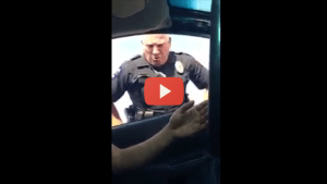 Angry Cop Threatens Teens For Smiling